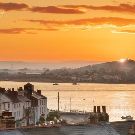 Sunset over Appledore roof tops