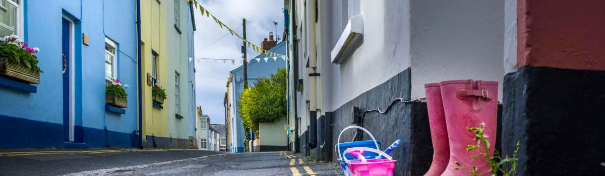 Narrow road in Appledore village with welliews and buckets on the doorstep